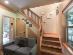 The staircase leads to upstairs bedrooms