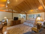 The upstairs great room is terrific for relaxing under the high exposed beam ceilings