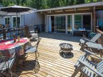 Many outdoor amenities include a large deck with grill and fire pit