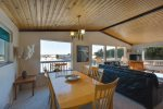 The dining area shares the living rooms large picture windows facing toward the beach