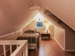 Upstairs sleeping nook with twin size trundle bed