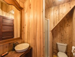 The upstairs bathroom has a shower to freshen up after a day playing in the great outdoors