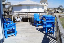 This beautiful second row vacation home in North Topsail Beach offers views of the Atlantic Ocean along with a hot-tub.