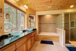Master Bath with jetted soaking tub and separate shower. Large walk-in closet