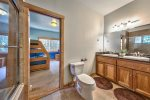 Jack-n-Jill bathroom with tub/shower combo.