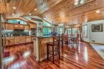 Incredible kitchen/great room with Cherry hardwood floors, and access to upper deck.