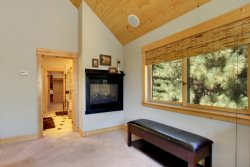 Master Suite, looking towards adjoining bathroom with see-through gas fireplace.