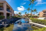 Landscaped grounds and waterway at the Bay Club at Waikoloa