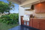 Outdoor summer kitchen with stainless BBQ