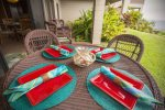 The large lanai features a table with comfortable seating for four