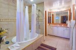 Unwind in your oversized soaking tub in your remodeled master bathroom