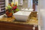 The master bathroom features a large soaking tub and shower