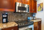 Custom cabinets, stainless steel appliances