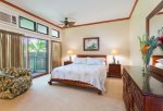 The master bedroom features a king bed, small lanai and AC