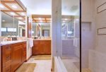 Enjoy two vanities and large walk-in shower