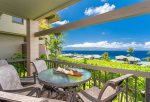 The large, private lanai features a table and seating for four