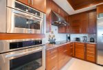 The kitchen features all luxury, high-end stainless steel appliances