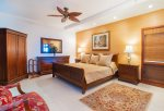 Unwind after a day at the beach in your master bedroom with king bed, flat screen TV and attached lanai