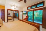 Enjoy a small, private lanai with garden views off of the bedroom