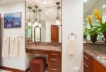 His-and-her vanities with custom cabinets and granite countertops