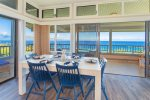 Intimate dining area with ocean views and a beautiful table with seating for six