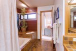 Roman style soaking tub, 2 separate vanities, private toilet in master bath