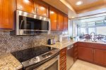 Custom crafted kitchen cabinets and ocean views from the sink