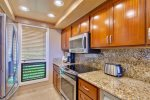 Remodeled kitchen with granite countertops, custom cabinets, stainless appliances