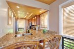 The breakfast bar with granite counter tops is the perfect place for morning pancakes and Kona coffee