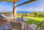 Huge grass area off lanai expands the feeling of spaciousness
