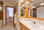 Spacious master bathroom offers twin vanities, perfect for getting ready for the day