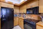 The kitchen offers a microwave, refrigerator and freezer, stove, over and dishwasher