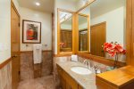 The remodeled guest bathroom features a shower, toilet and vanity