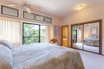 The master bedroom features a king bed and small, private lanai