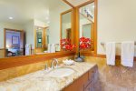 Master Bath tub is high-end remodel with large soaking tub, two separate vanities, custom lighting and private toilet