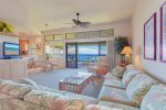 Relax after a long day in this comfortable living room with ocean views