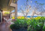Relax on your large lanai with outdoor seating and incredible views