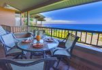 Dining table off kitchen features ocean views dreams are made of