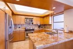 The kitchen features beautiful recessed ceiling and lighting, and ocean views from the sink