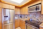 Gold remodel kitchen, stainless appliances and granite counter tops