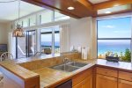 The kitchen is fully stocked with everything you need- plus ocean views