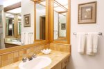 There`s more than enough room for everyone to get ready for the day in this large master bathroom