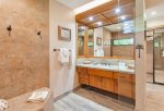 The remodeled master bath is the perfect place to unwind after a long day playing on the beach