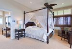 The master bedroom features canopy bed, sitting area with pull-out sofa, private lanai and jaw dropping ocean views