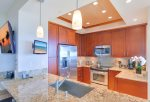 The high-end kitchen features all stainless steel appliances and ocean views from your work space