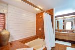 Unwind after a long day in the surf in your spacious master bath