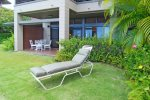 A spacious grass area is an added bonus to your large lanai