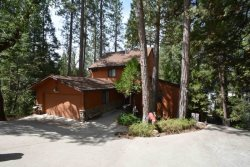 This beautiful 3 bedroom/2 bath home has lots of windows and decking to enjoy the peaceful setting amongst the Pines & cedar trees at Bass Lake Estates