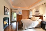 This relaxing master bedroom has a queen bed and adjoining bathroom