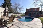 This great backyard has a pool and hot tub along with great outdoor seating areas